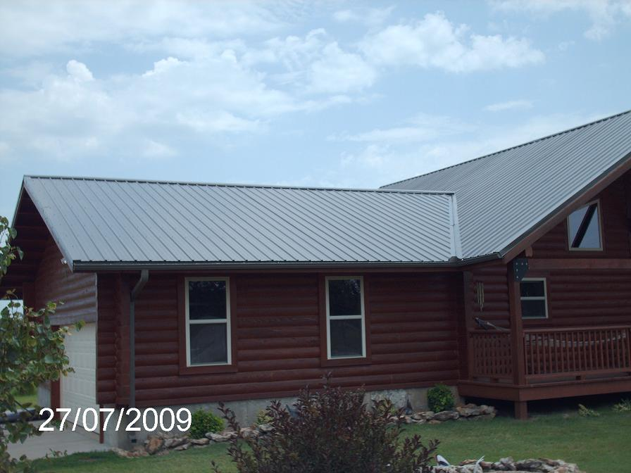 This Beautiful Log Home Was Covered By The Barn Guys 29 Gauge Panel Loc  Plus Metal. Color Is Burnish Slate. Metal Was Attached With Color Matching  Screws.